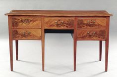 A Southern Federal Mahogany Huntboard, c. 1785-1800, the serpentine top above a narrow drawer, flanked by deep bottle drawers, each faced and strung as a pair of drawers, on square tapered legs, height 37 in., width 66 in., depth 26 1/2 in.