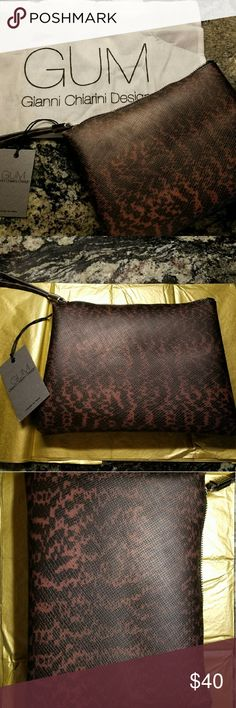 "GUM Gianni Chiarini PVC  zipper tote. NWT. Made in Italy. This GUM Gianni Chiarini Design is made from PVC. A. beautiful brown and black leopard type pattern with silver tone Hardware. Measures 10""Lx7""H. The tote also comes with a white handle, monogrammed cloth bag. gianni chiarini  Bags Totes"