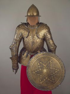 Half-Armour and Buckler Author:	 Country:	Italy Collection:	Arms and Armour Date:	First quarter of the 17th century Technique:	chased, engraved and gilded