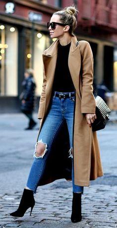 Helena Glazer + kills it + cute winter style + distressed denim jeans + oversized camel coat + spike heeled booties + perfect edgy feel! Coat: Mackage, Bodysuit: Only Hearts, Denim: Levis, Belt: Saint Laurent, Booties: Louboutin. #womensfashion