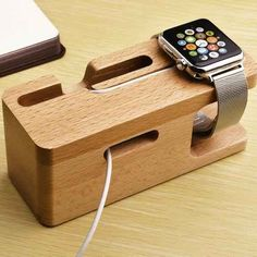 Display and charge your device with the multi-function Wood Charging Dock. Specially designed to dock your smart phone and/or smart watch while charging. Wooden stand is a solid build for better stabilization. Two cutouts allow for charging of both devices while hiding unsightly cords. Natural wood looks classy in your home or office. Multifunction cradle holds your iWatch, iPhone, Samsung and more Keeps your desk or counter neat Block stand is sturdy yet lightweight Neutral wood color ...