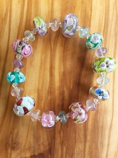 Check out this item in my Etsy shop https://www.etsy.com/uk/listing/531528226/glass-lamlwork-encased-floral-beads