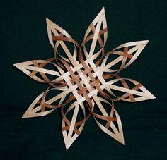 Carolina Star, walnut and maple. Contrasting wood spokes really enhances this weaving visually.