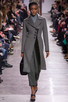 I love it (Zac Posen look #33) - the assymetrical cut, the drapey pants, the high-neck top