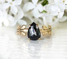 This black diamond wedding ring is gorgeous.