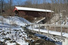Built between 1851 and 1853, the Newfield Covered Bridge is one of the few working covered bridges in New York State and the oldest covered bridge in the state open to vehicular traffic. Located just off Main Street in the Town of Newfield (Tompkins County), the bridge spans the west branch of Cayuga Creek, the inlet to Cayuga Lake. The bridge interior is Town lattice truss. It is on the National Register of Historic Places.
