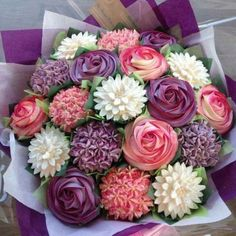 """Cupcake Bouquet Tutorial With Video Instructions. Use a 5"""" Styrofoam ball cut in half, with 11 cupcakes. Roses, hydrangea, carnations, dahlias."""