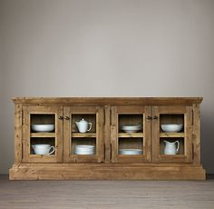 RH's Salvaged Wood Glass Sideboard:Stout pine timbers, salvaged from 100-year-old buildings in Great Britain, give this distinctive sideboard exceptional character.