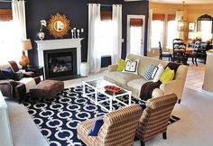 navy blue living room, love the rug, gold accents, bamboo blinds, and furniture arrangement