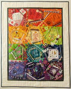 Sewing Crazy Quilt ©Debra Spincic, 2013  great crazy quilt using urban threads designs as block centres.