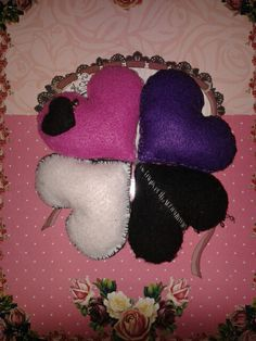 Handmade little plush hearts .