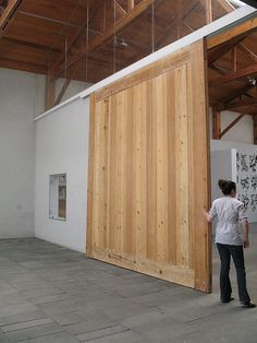 A large sliding gate that could at any time separate or merge our office space with the prototyping space.