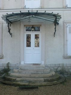 Porte d 39 entr e contemporaine rehauss e d 39 une marquise for Decoration maison de maitre