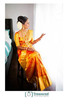 South Indian bride. Temple jewelry. Jhumkis.Mustard yellow silk kanchipuram sari.Braid with fresh jasmine flowers. Tamil bride. Telugu bride. Kannada bride. Hindu bride. Malayalee bride.Kerala bride.South Indian wedding