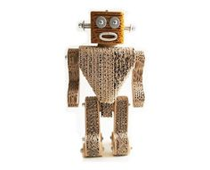 Perfect for the kids or for the robot collector of the family! These fun robots are made from recycled cardboard, posters, metal bolts and bottle caps.