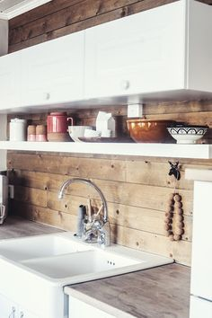 white kitchen with wooden backsplash // sans for sånt #kitchen_shelves