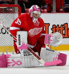 Now THAT's Aa real man.Wearin 'o' tha Pink Jimmy Howard of the Detroit Red Wings wears his customized pads and mask on Breast Cancer Awareness Night at Joe Louis Arena. (Photo by Dave Reginek/NHLI via Getty Images) Goalie Gear, Goalie Mask, Hockey Goalie, Hockey Mom, Hockey Teams, Hockey Players, Ice Hockey, Hockey Stuff, Sports Teams