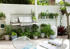 container garden and bbq on wooden deck