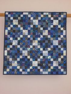 Blue Postage Stamp wall quilt. $500.00, via Etsy.