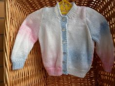 This girls' cardigan fits a 20 inch chest or a 6 month - 1 year old. It is knitted in marble yarn in pink blue and white. by Marionsknittedtoys on Etsy