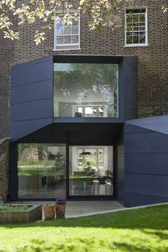 Tapered extension by Alison Brook Architects designed to draw light in from the sky