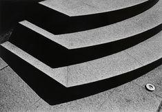 Photographs of Atget, Moriyama, and Weegee on the same walls