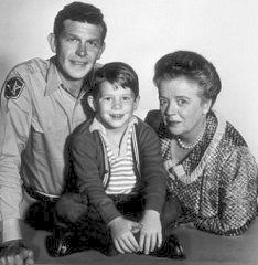 "Andy Griffith as Sheriff of Mayberry, Ron Howard as Andy's son Opie, and Frances Bavier as Aunt Bee ~ all of ""The Andy Griffith Show."""