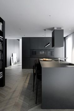 charcoal grey kitchen on a raw parquetry timber floor - beautiful clean lines