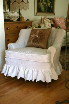 Matelasse bedspread used to make slipcover. By Custom Slipcovers by Shelley
