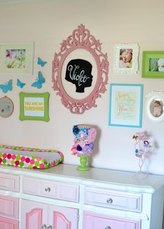 Sweet, colorful gallery wall over the changing table - #nursery