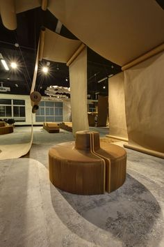 JC architecture drapes café in taipei with rolls of brown paper Happy Cafe, Architecture Design, Modular Design, Cafe Bar, Brown Paper, Taipei, Building Materials, Natural, Branding Design