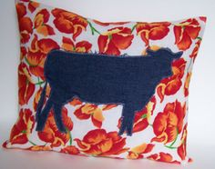 $42.00 Cow & Orange Poppy handmade pillow. This cow silhouette is made from a very lightweight denim and appliqued right on this gorgeous lightweight orange poppy fabric. This pillow is all about country spring on the farm. This accent or throw pillow is great rustic home decor. Made by Bundles of Blossoms and for sale on Etsy, Facebook, Pinterest, Twitter, and Bundles of Blossoms Blog.