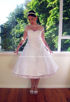"1950's ""Annette"" White Wedding Dress with Polka Dot Overlay, Sweetheart Neckline, Tea Length Skirt and Petticoat - Custom made to fit. $345.00, via Etsy."