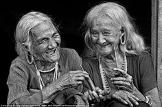 Having a laugh: Two old friends share a few jokes while smoking their pipes in Vietnam captured by Huu Hung Truong: