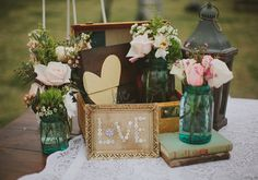 pardon the pun but I love the love sign in the frame.  burlap on the background and buttons to form word