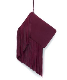 Combining two of the season's biggest trends—marsala and fringe—this suede clutch makes a simple outfit look more current in one swift maneuver, while also tying together any assortment of neutral or jewel tones.