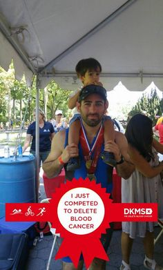 Team DKMS athlete Jonathan Levy with his son.