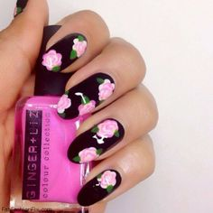 Black nails with flower nail art