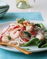 The classic flavors of Thai cuisine—sweet, salty, spicy, sour—can all be found in the dressing on this salad, a delicious tangle of chewy rice noodles, shrimp, squid and peanuts.