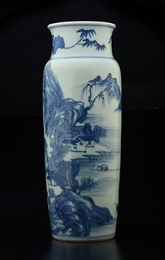 """A BLUE AND WHITE PORCELAIN VASE, decorated with houses and a lake in a mountaineous landscape. QING DYNASTY. H: 36.5cm - 14.375"""""""