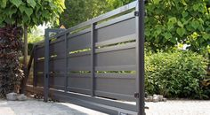 Sliding gate / metal / bar / panel - MODERN SYSTEM - WISNIOWSKI