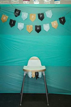$2 SHOP TABLECLOTHS MAKE FOR A PERFECT BACKDROP.  Colour theme if you cant tell was mint, gold, black and white.  The banner was just done using word and printed 2 per at paper, cut them out and pegged them to some string. Mint Gold, Tablecloths, Color Themes, Backdrops, Banner, Colour, Black And White, Chair, Printed