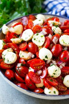 A serving bowl of tomato mozzarella salad with cherry tomatoes, herbs and red onion. dinner recipes side dishes Cherry Tomato Salad - Dinner at the Zoo Cherry Tomato Recipes, Cherry Tomato Salad, Tomato Salad Recipes, Spinach Salads, Salade Caprese, Tomato Caprese, Dinner Side Dishes, Dinner Salads, Dinner Table