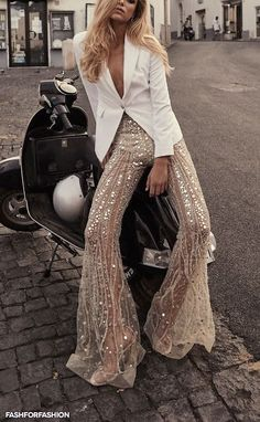 sequin bell bottom pants matched with a no nonsense white blazer. casual luxury, high fashion, italian euro glamour, date night outfits Look Fashion, High Fashion, Womens Fashion, Fashion Design, Curvy Fashion, Fall Fashion, Latex Fashion, Steampunk Fashion, Victorian Fashion