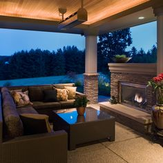Outdoor covered patio with fireplace, Kaufman Homes Inc., photo © Rick Keating, RK Productions  http://www.rickkeatingphotographer.com/