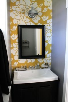 cool way to bring some fun into a small bathroom. one little wall with wallpaper :) not to mention gray and yellow! <3