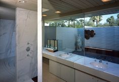 Mid Century Marble by Michael Haverland Architect, a renovation in Palm Springs that is true to the period using marble from the era