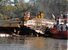 Firefighters work amid the smoldering wreckage of the Amtrak Sunset Limited passenger train at Big Bayou Canot in 1993. The train derailed Sept. 22, 1993, in northeast Mobile, Alabama, killing 47 and injuring 103. It is the deadliest train wreck in Amtrak's history. Press-Register file.