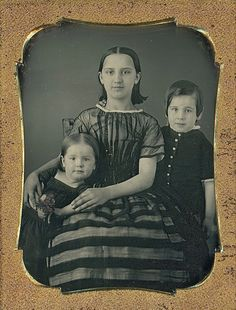 This daguerreotype features a trio of young siblings pleasantly posed together. The star of the image, the beautiful teenage girl in the middle, wore a stunning striped dress and kept her dark her down. | eBay!