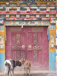 Dark pink doors. Colorful doorway. Tibet